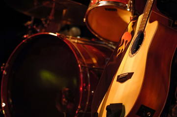 drums kit and acoustic guitar on stage