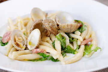Spanish cuisine. Pasta with Clams and Chorizo
