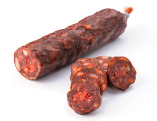 Iberian sausage cut isolated on white
