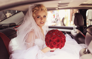 Beautiful bride smile in a luxury car