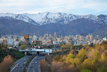 Tehran Skyline and Highway in Front of Snowy Mountains