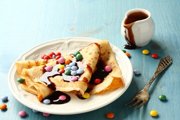 Homemade crepes with multicolored dragee