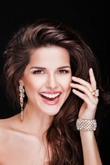 portrait of a beautiful brunette girl with luxury accessories.