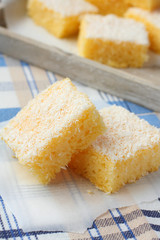 Semolina cake with coconut on a blue background