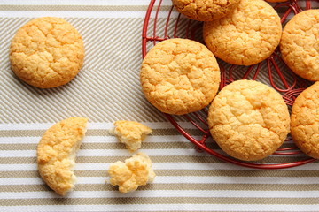 Homemade coconut cookies on red grid