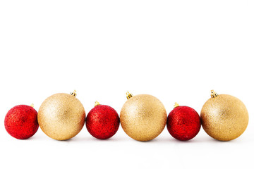 red and golden christmas decoration balls on a white background