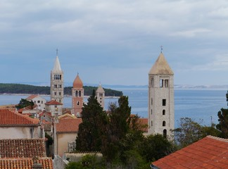 The four church towers of the city Rab in Croatia
