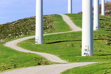 closeup of wind turbine towers with path