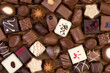 Various chocolates on wooden background - 73882005
