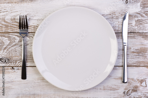 Empty plate on wooden background - 73882230