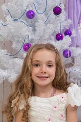 Little girl over fir tree