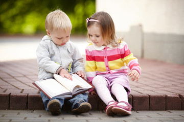 funny boy and girl reading book