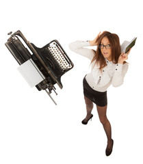 Secretary with long legs and a typewriter