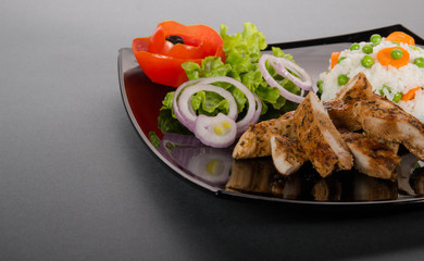 Grilled chicken meat with fresh vegetable