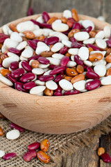 various beans in a wooden bowl