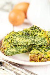 Homemade Italian spinach or Swiss chard frittata omelet