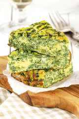 Stack od sliced Italian spinach frittata