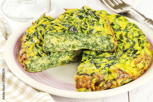Homemade Italian spinach or Swiss chard frittata omelet - 73884234