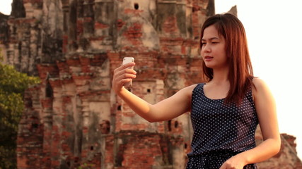 Asian female using smartphone
