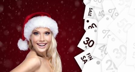 Beautiful woman in Christmas cap with good seasonal offer