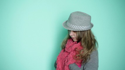 beautiful girl in a hat with a pink scarf