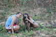 Постер, плакат: Nature photographers Man and woman in jungle