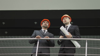 The builders discuss the project at the balcony