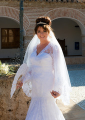 Bride in a Spanish Courtyard in the Sunshine