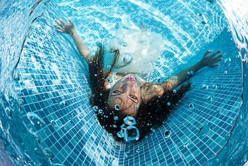 Beautiful woman swiming underwater