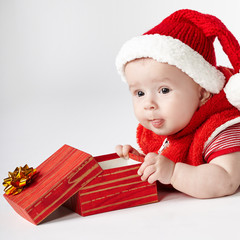 cute christmas baby with gift