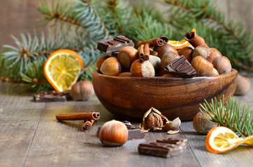 Hazelnuts with chocolate and cinnamon in a wooden bowl.