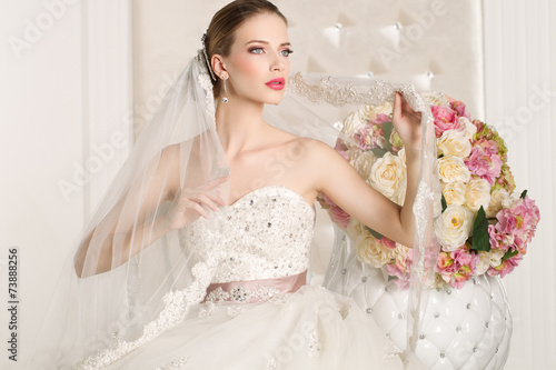 Gorgeous bride with white dress with flowers bouquet - 73888256