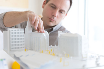 Young architect working on a new architectural model