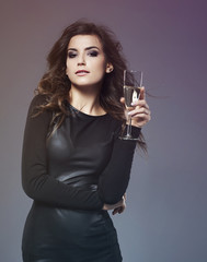 Elegant woman drinking luxurious champagne