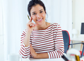 Young businesswomen working in her office.