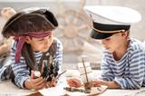 Boys play in the sea battle