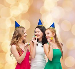 smiling women holding glasses of sparkling wine