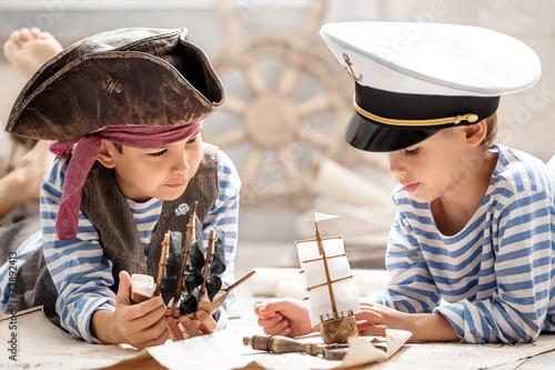 Boys play in the sea battle - 73892413
