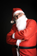 xmas man with red santa claus dress looking down thinking