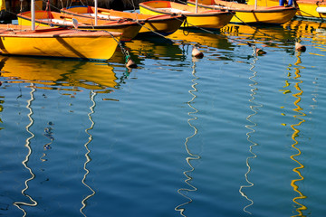 .yellow boats with masts