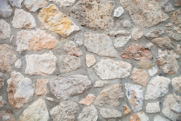 Wall built of natural stone