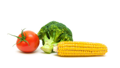 corn, broccoli and ripe tomatoes isolated on white background