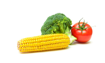 ear of corn, broccoli and tomato isolated on white background
