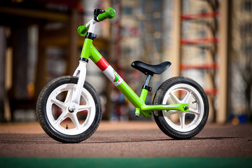 Green kids bike. Children's Bicycle green color on the site.