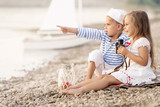 Boy with a girl sitting on the beach