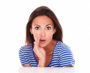Pretty woman in blue t-shirt whispering a secret
