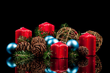 Christmas candles on a black background