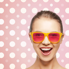 happy laughing teenage girl in pink shades