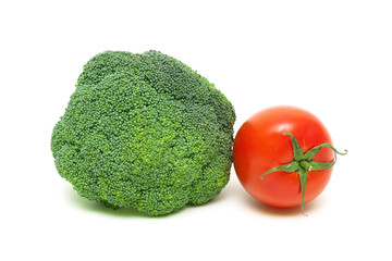 broccoli and ripe tomatoes isolated on white background close-up