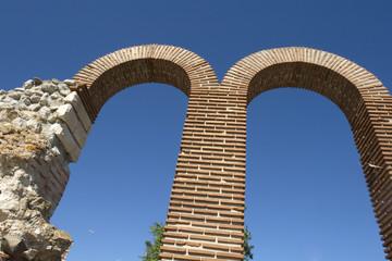 Two high brick semicircular arches